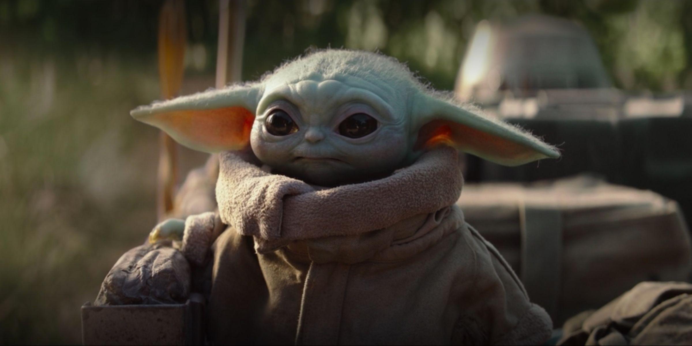 Dwayne Johnson Snuggles The Mandalorians Baby Yoda In Fan Art